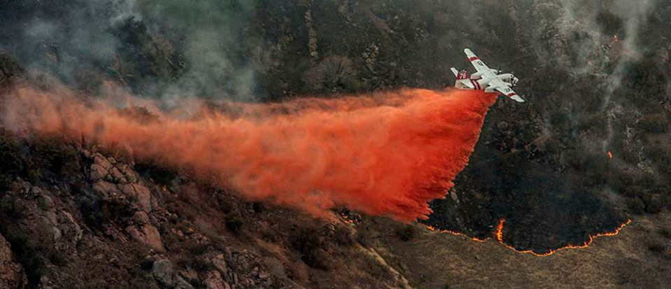A CalFire S-2 tanker makes a drop
